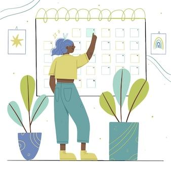 Frau, die freizeitkleidung trägt, die ein datum auf kalender bucht