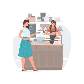 Frau, die für getränk im kaffeehaus zahlt