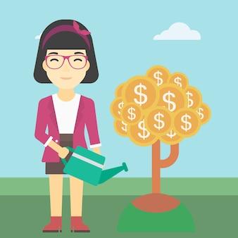Frau, die geldbaum wässert