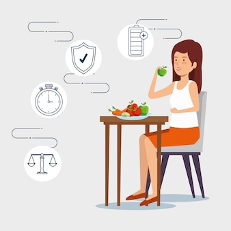Frau, die gemüse und früchte zum gesunden lebensstil isst