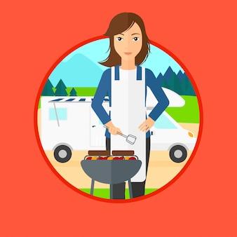 Frau, die grill vor reisemobil hat.