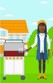 Frau, die grill vorbereitet