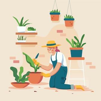 Frau, die handschuhe trägt und ihre pflanzen im garten arbeitet