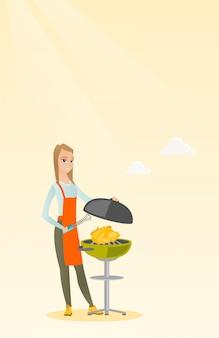 Frau, die huhn auf grillgrill kocht.