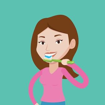 Frau, die ihre zähne putzt.