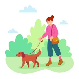 Frau, die ihren hund geht