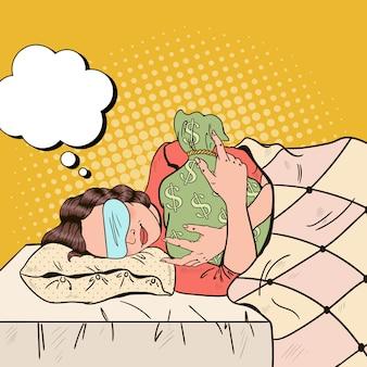 Frau, die im bett mit geldsack schläft