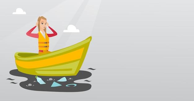 Frau, die in ein boot im verschmutzten wasser schwimmt.