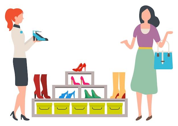 Frau, die in mode butike der schuhe wählt