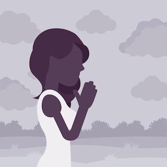Frau, die in namaste-geste betet