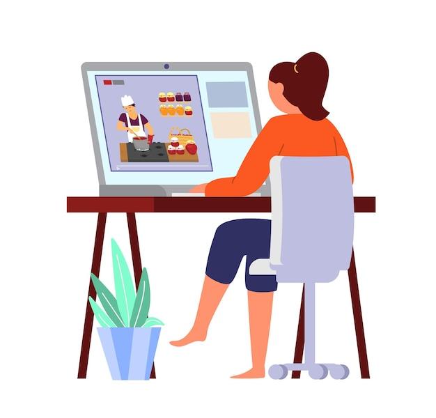 Frau, die kochblog auf laptop beobachtet.