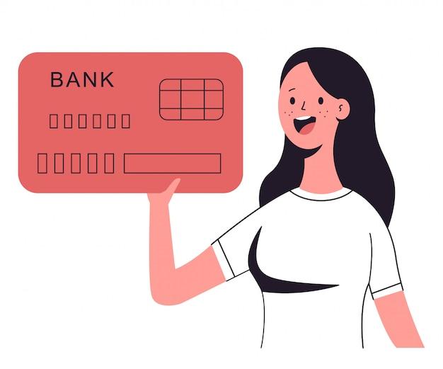 Frau, die kreditkarte hält