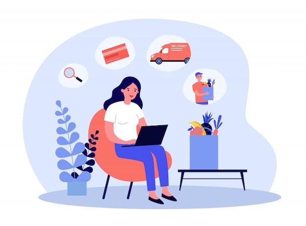 Frau, die laptop für lebensmittellieferauftrag verwendet