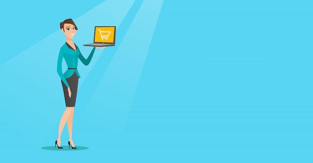 Frau, die laptop mit laufkatze auf einem schirm hält.
