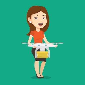 Frau, die lieferdrohne mit postpaket kontrolliert