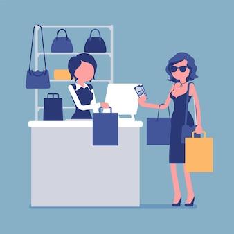 Frau, die mit bargeld an der handtaschenabteilung zahlt