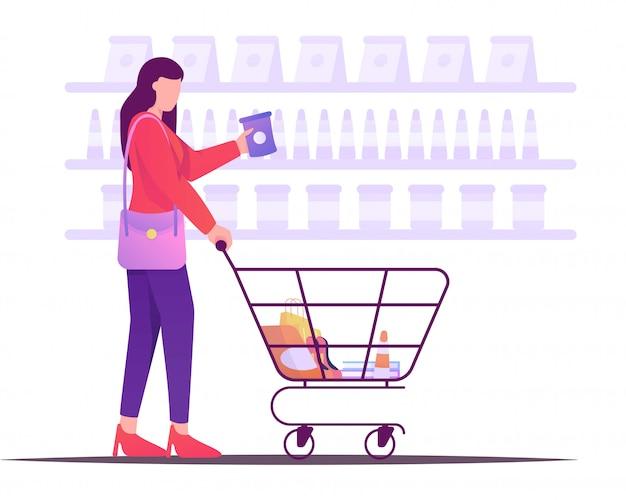 Frau, die mit flacher illustration des warenkorbes kauft