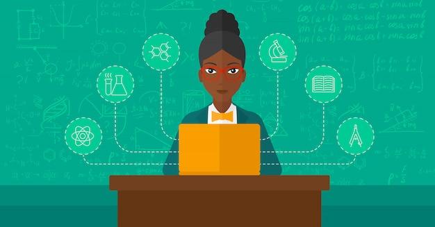 Frau, die mit laptop studiert