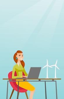 Frau, die mit modell von windkraftanlagen arbeitet.