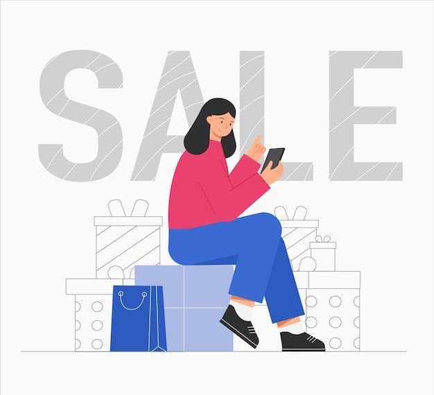 Frau, die mit paketen auf geschenkbox sitzt und online einkauft, mit einkaufstasche.