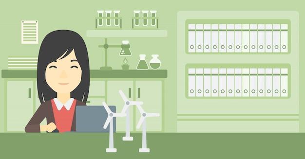 Frau, die mit vorbildlichen windkraftanlagen auf tabelle arbeitet.