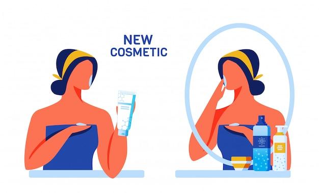Frau, die neue kosmetik für gesicht und körper prüft
