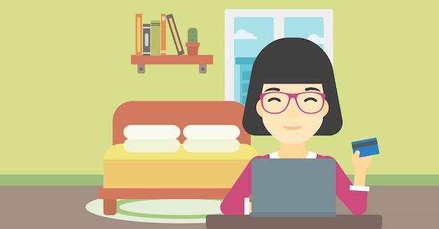 Frau, die online unter verwendung ihres laptops kauft.