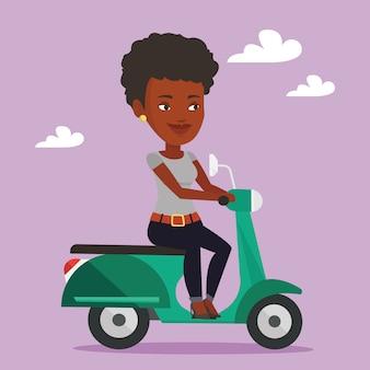 Frau, die roller reitet