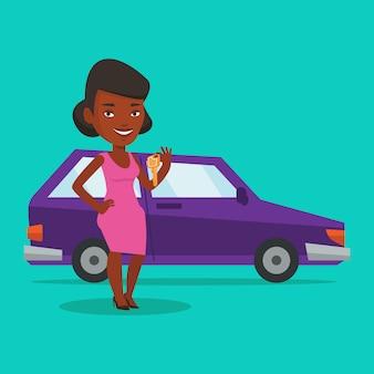 Frau, die schlüssel zu ihrem neuen auto hält.