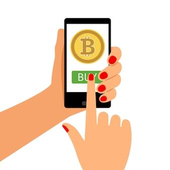 Frau, die smartphone mit bitcoin hält