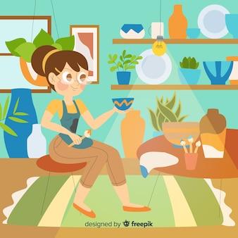 Frau, die tonwaren macht und malt