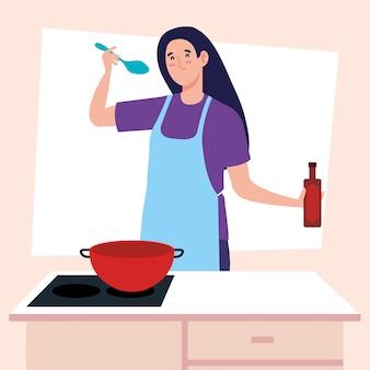 Frau, die unter verwendung der schürze mit herd kocht, und liefert küche