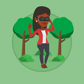 Frau, die virtual-reality-headset im park trägt.