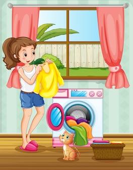 Frau, die wäsche im haus macht