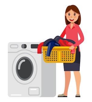 Frau, die wäschekorb mit waschmaschine hält
