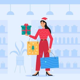 Frau, die weihnachtseinkäufe macht