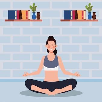Frau, die yoga im haus praktiziert
