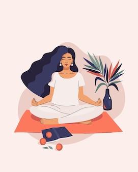 Frau, die yoga in lotussitz macht
