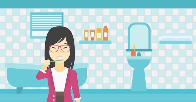 Frau, die zähne putzt
