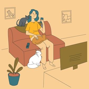 Frau, die zeit mit ihren flauschigen katzen verbringt