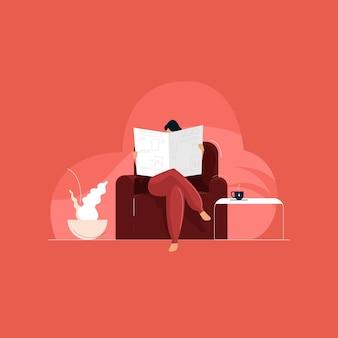 Frau, die zeitung liest, die auf sofa im raum sitzt