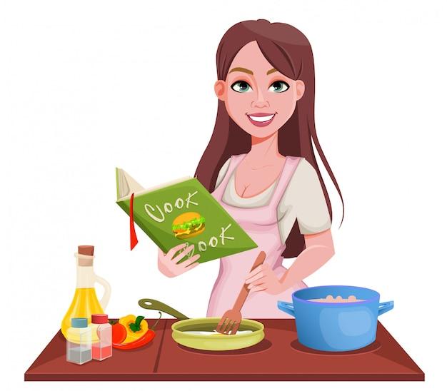 Frau, die zu hause kocht. fröhliches mädchen