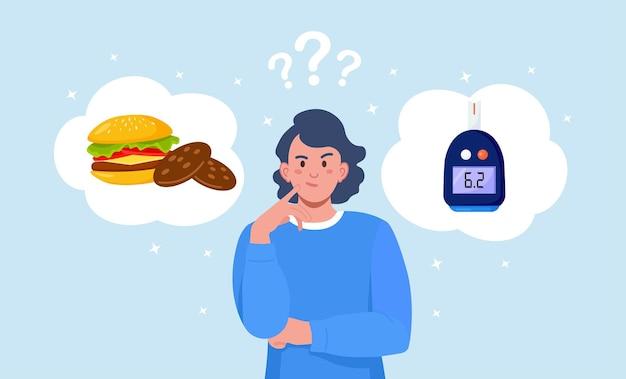 Frau, die zwischen burger, keksen und normalem blutzuckerspiegel wählt. mädchen, das an süßigkeiten, fast food und an glucometer denkt. wahl zwischen diabetes und gesundheit