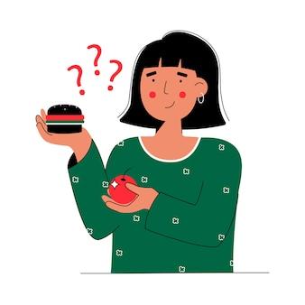 Frau, die zwischen gesundem gemüse und obstnahrung und ungesundem lebensmittelburger wählt