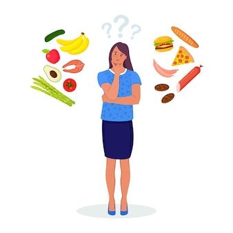 Frau, die zwischen gesundem und ungesundem essen wählt. fast food und ausgewogener menüvergleich, diät. wahl zwischen guter und schlechter ernährung