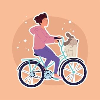 Frau fährt fahrrad mit hund