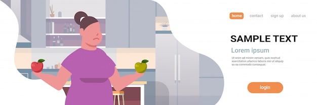 Frau hält äpfel mädchen essen früchte fettleibigkeit gewichtsverlust diät konzept gesunde ernährung modern
