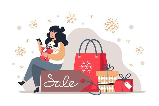 Frau hält ein smartphone in ihren händen und sitzt auf einem rabattanhänger