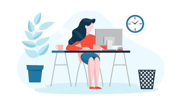 Frau im anzug sitzt am schreibtisch und arbeitet