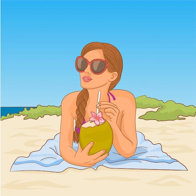 Frau im bikini mit kokosnuss am strand